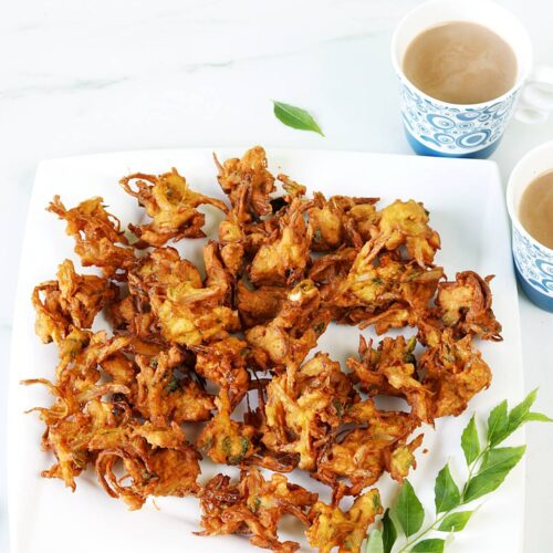 onion pakoda served in a white plate