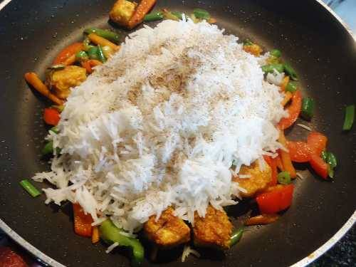 add rice and crushed pepper for paneer fried rice