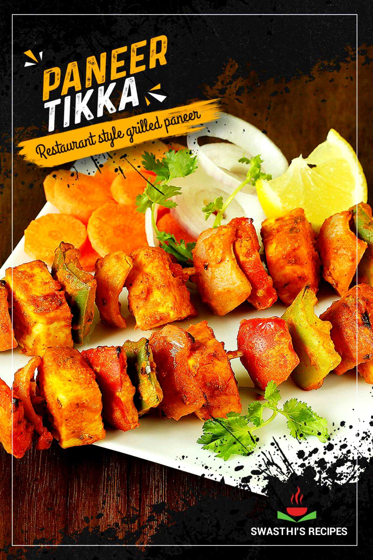 paneer tikka served in a white plate with onions & lemons