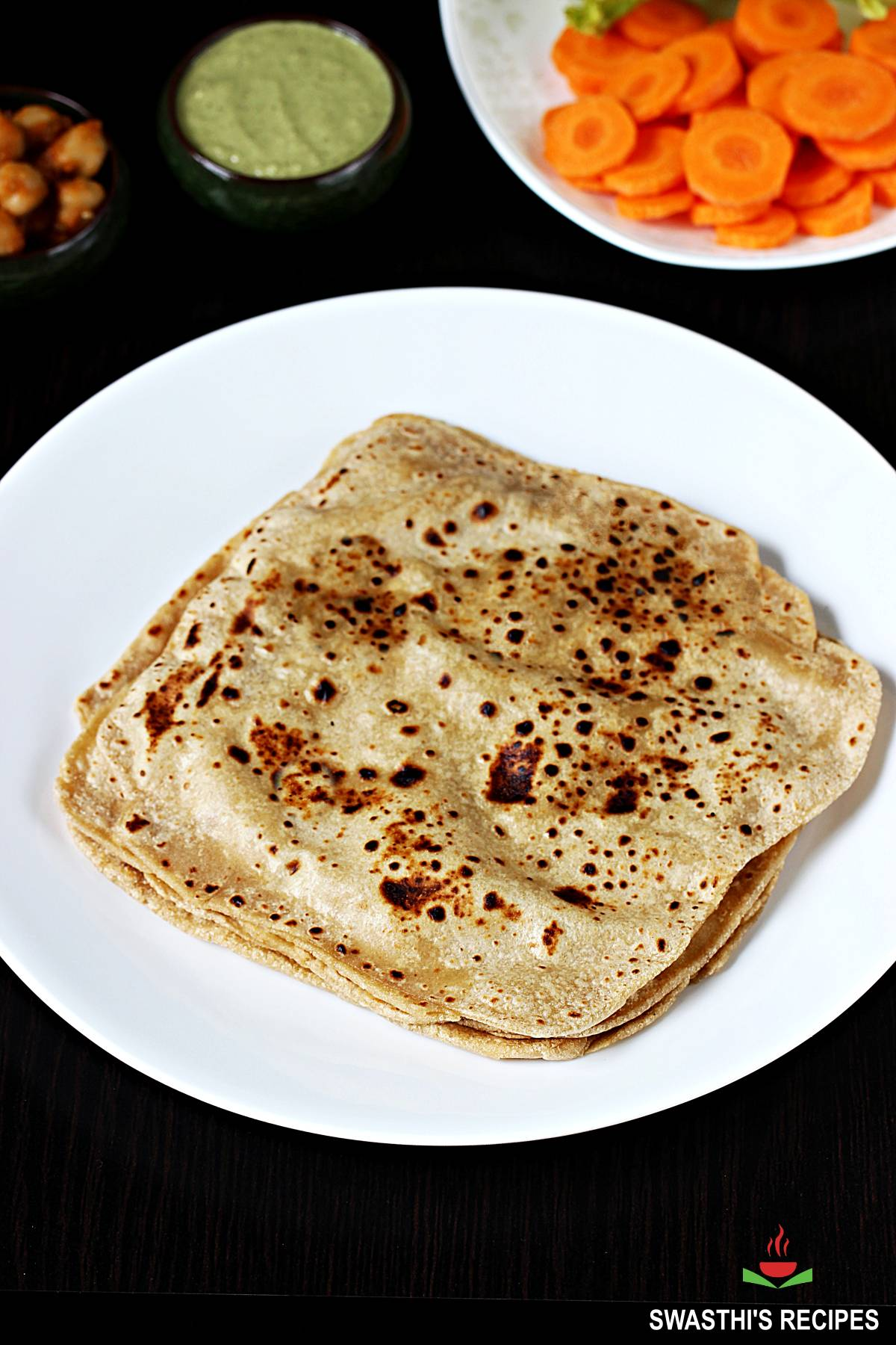 paratha served with chutney and vegetables