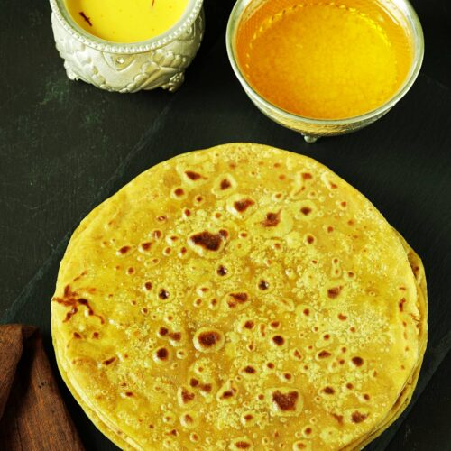 puran poli served in a black plate