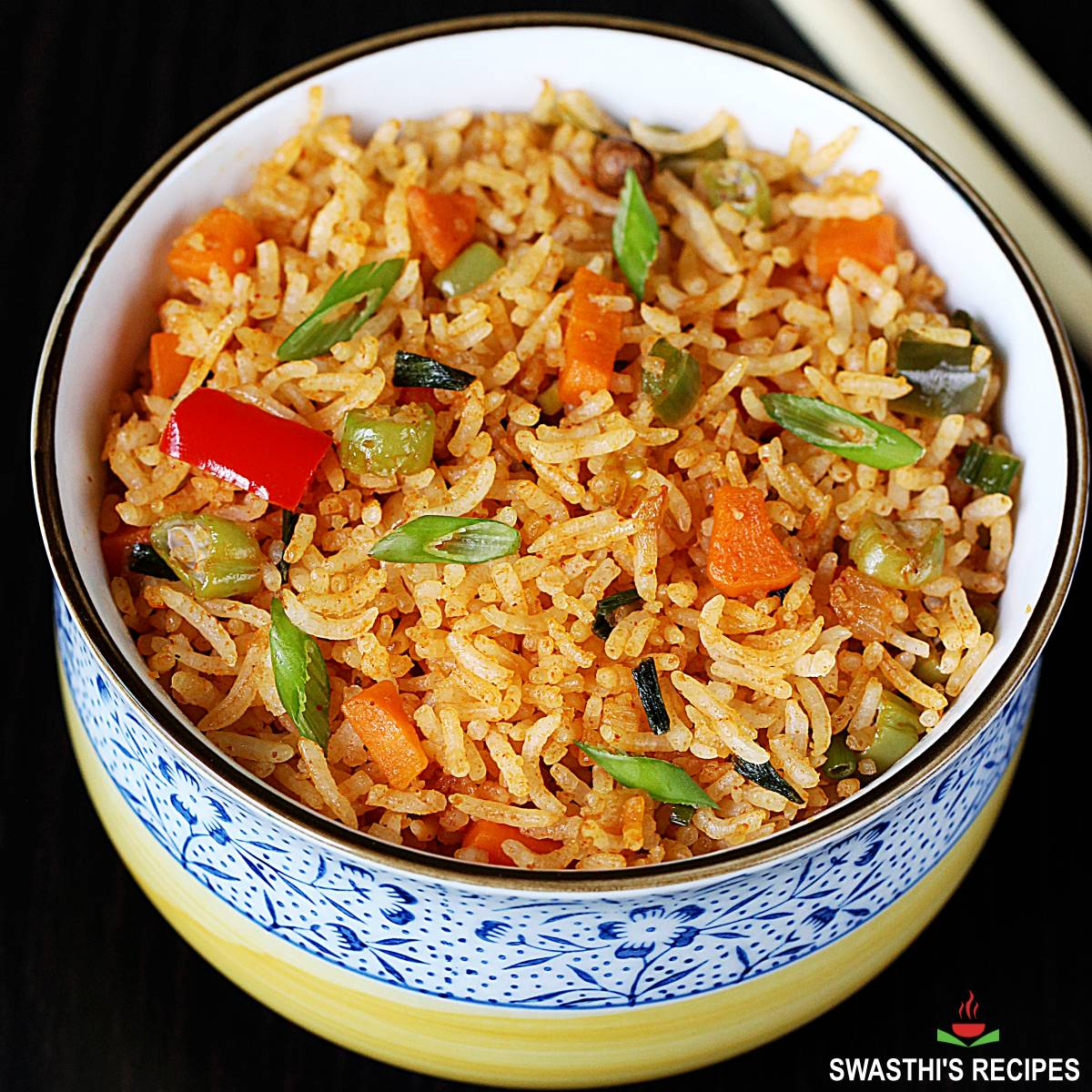 schezwan fried rice garnished with spring onions