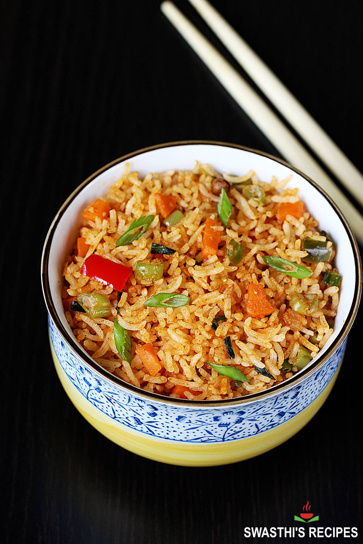 schezwan fried rice served in a white bowl