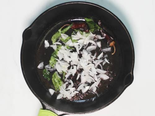 frying onions to make kadala curry