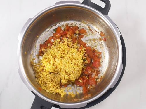 rinsed moong dal being added to cooker
