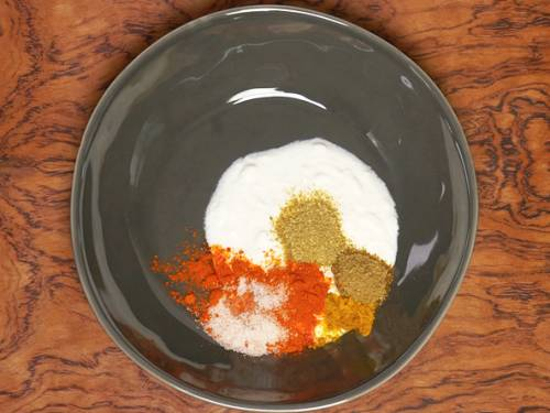 yogurt and spices in a bowl to make paneer tikka