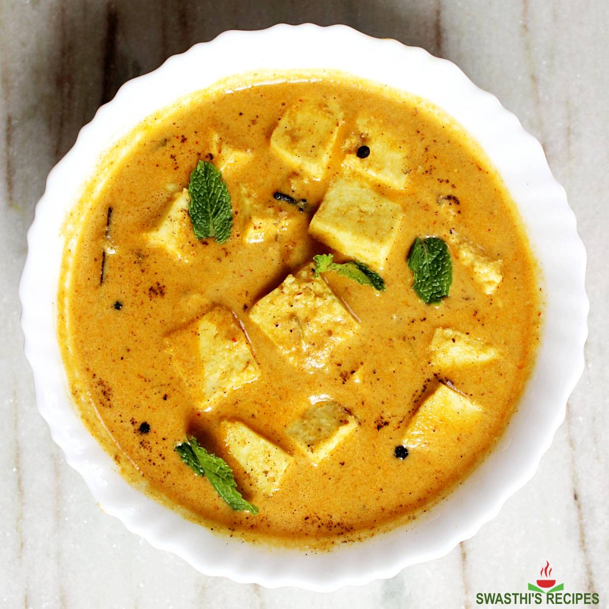 shahi paneer served in a white bowl