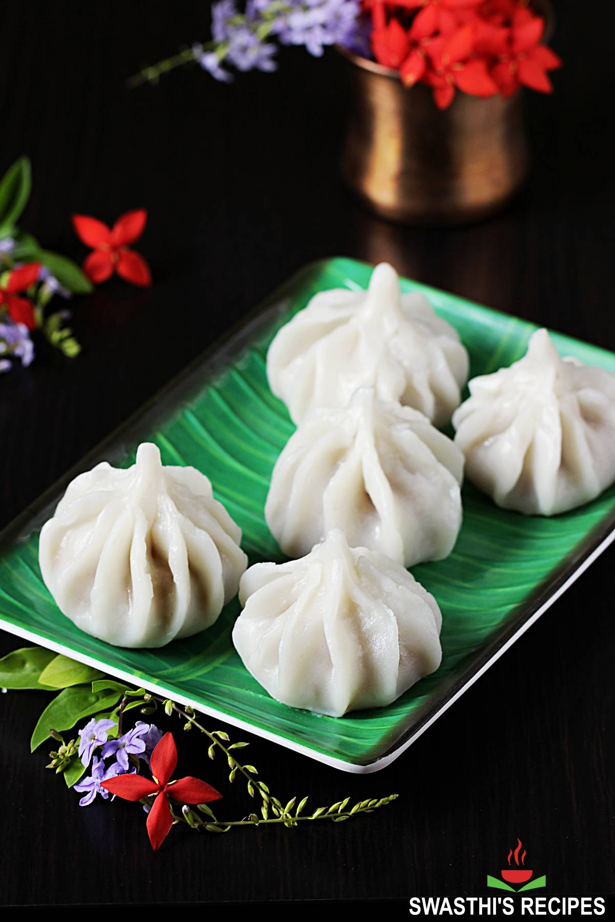 ukadiche modak offered in a green plate during Ganesh Chaturthi pooja