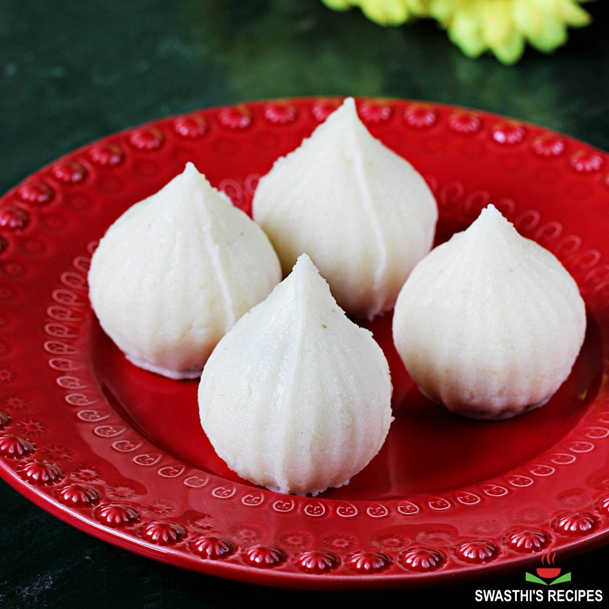 rava modak offered in a red plate