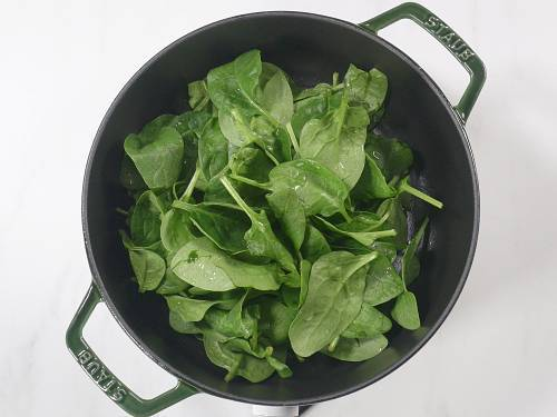 spinach in a pot to make soup